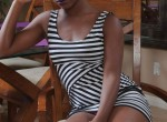 Sierra - creamy ebony strips out of her striped dress