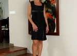 Mature blond Carrie slips out of her black dress.