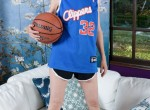 Mature Jamie removes her basketball outfit.
