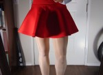 Miss Lauren in a red skirt showing her feet in white stockings