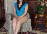 Karen Preggo strips out of a blue nightie
